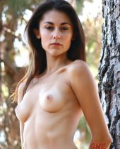 Gorgeous skinny nudist girl in the forest